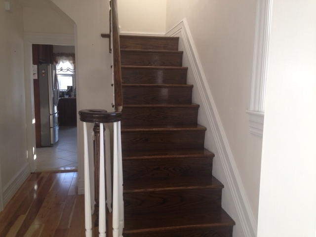 finished-wood-stairs-rails-installation