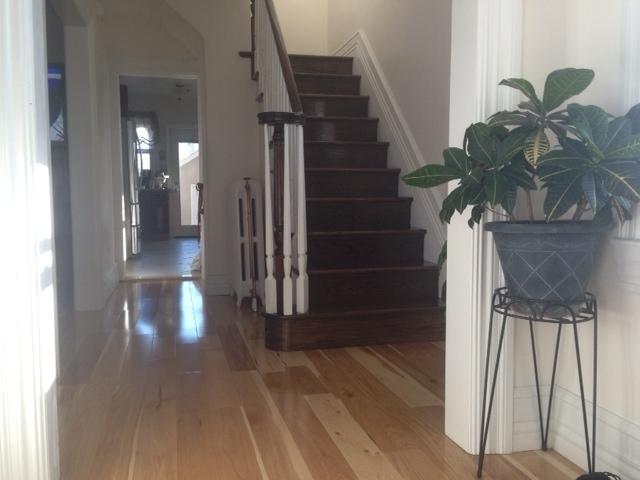 new-install-hardwood-floor-with-steps-and-rails